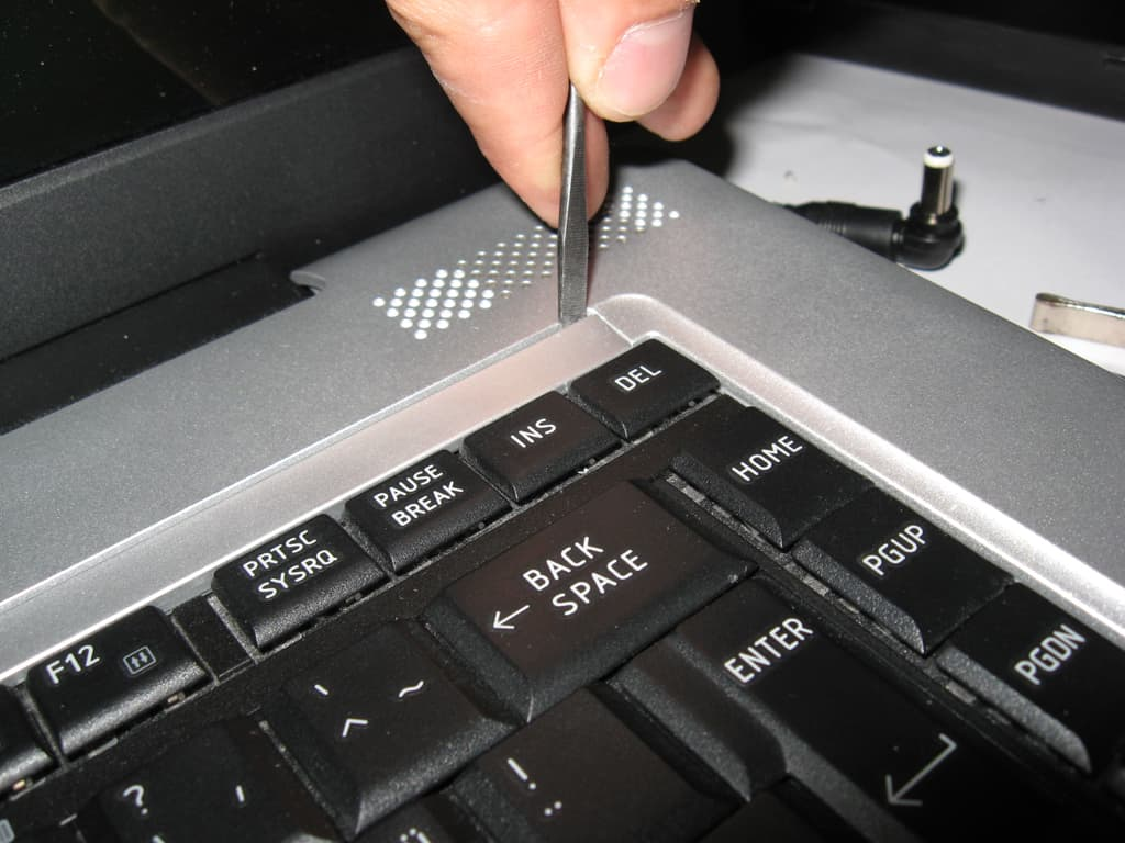 Remove the cover for keyboard screws. Underneath the keyboard is